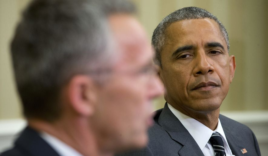 President Barack Obama listens as NATO Secretary General Jens Stoltenberg speaks to members of the media during their meeting, Tuesday, May 26, 2015, in the Oval Office of the White House in Washington. (AP Photo/Pablo Martinez Monsivais)