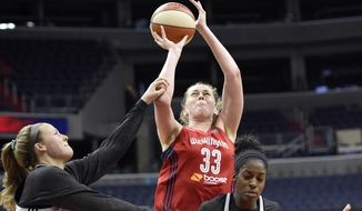 Washington Mystics' Emma Meesseman (33) goes to the basket against  Minnesota Lynx Tricia Liston (20) and Devereaux Peters (14) during an WNBA basketball special analytic scrimmage, Tuesday, May 26, 2015, in Washington. (AP Photo/Nick Wass) **FILE**