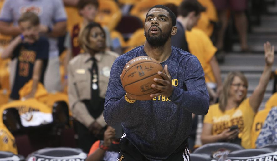 Cleveland Cavaliers guard Kyrie Irving warms up before the Cavaliers played the Atlanta Hawks in Game 4 of the NBA basketball Eastern Conference finals, Tuesday, May 26, 2015, in Cleveland. (AP Photo/Ron Schwane)