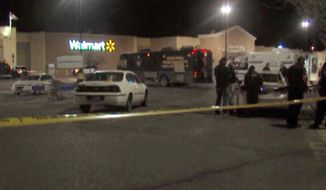 In this photo provided by WDAZ-WDAY TV Grand Forks-Fargo, police investigate the scene of a shooting at a Wal-Mart Supercenter store Tuesday, May 26, 2015, in Grand Forks, N.D. Grand Forks Police said the deadly shooting occurred a few minutes after 1 a.m. (Matt Henson/WDAZ-WDAY TV Grand Forks-Fargo via AP)