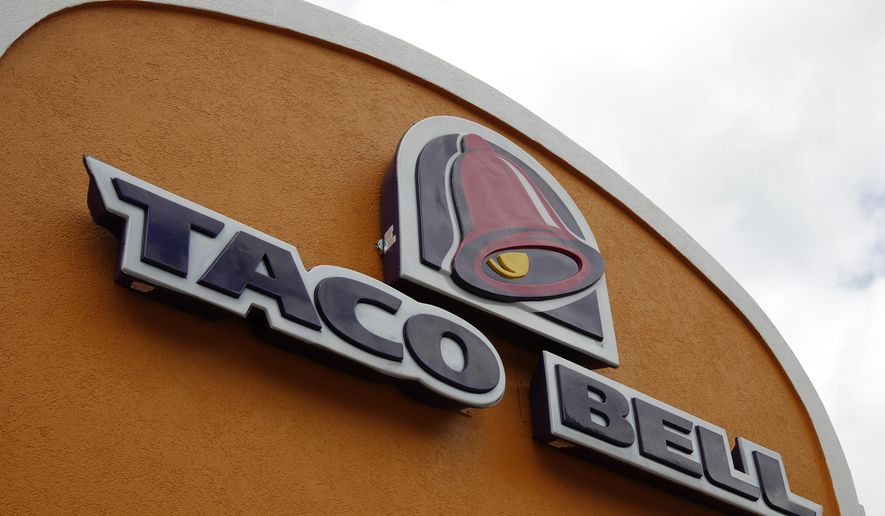 This Friday, May 23, 2014, file photo shows a sign at a Taco Bell in Mount Lebanon, Pa. (AP Photo/Gene J. Puskar, File)
