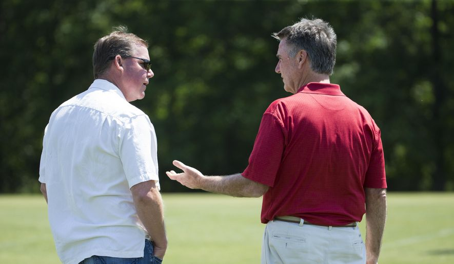Washington Redskins general manager Scot McCloughan, left, talks with team president Bruce Allen during an NFL football organized team activity at Redskins Park, on Tuesday, May 26, 2015, in Ashburn, Va. (AP Photo/Evan Vucci) **FILE**