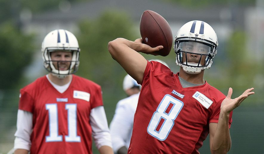 Tennessee Titans quarterback Marcus Mariota (8) passes as Alex Tanney (11) looks on during an organized team activity at the team's NFL football training facility Tuesday, May 26, 2015, in Nashville, Tenn. (AP Photo/Mark Zaleski)