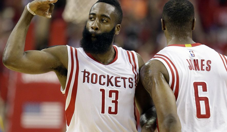 Houston Rockets guard James Harden (13) celebrates with forward Terrence Jones (6) after a 3-point basket against the Golden State Warriors during the first half in Game 4 of the NBA basketball Western Conference finals Monday, May 25, 2015, in Houston. (AP Photo/David J. Phillip)