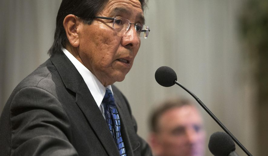 Hopi Chairman Herman Honanie speaks during a news conference on the Paris auctions selling Hopi sacred objects,Wednesday, May 27, 2015 at the Heard Museum in Phoenix. Hopi tribal leaders and Arizona's members of Congress are asking U.S. law enforcement to stop the sale of about a dozen sacred Hopi artifacts at a Paris auction house in June.  (Mark Henle/The Arizona Republic via AP)  MARICOPA COUNTY OUT; MAGS OUT; NO SALES; MANDATORY CREDIT