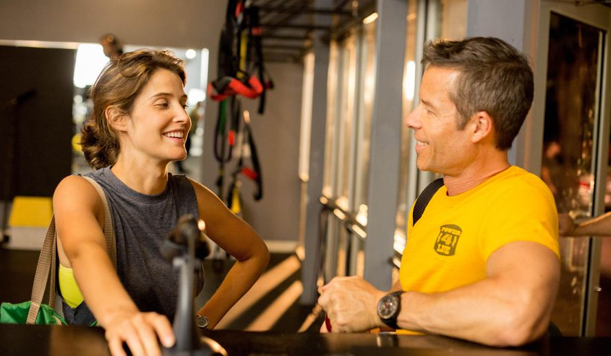 """This photo provided by courtesy of Magnolia Pictures shows, Cobie Smulders, left, and Guy Pearce, in a scene from the film, """"Results,"""" a Magnolia Pictures release. (Ryan Green/ Magnolia Pictures via AP)"""