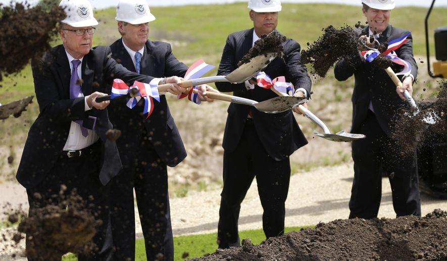 Department of Homeland Security Jeh Johnson, second from right, breaks ground on the National Bio and Agro-Defense Facility with Sen. Pat Robers, R-Kan., left, Gov. Sam Brownback, right, and Department of Agriculture Tom Vilsack, second from left, in Manhattan, Kan., Wednesday, May 27, 2015. (AP Photo/Orlin Wagner)