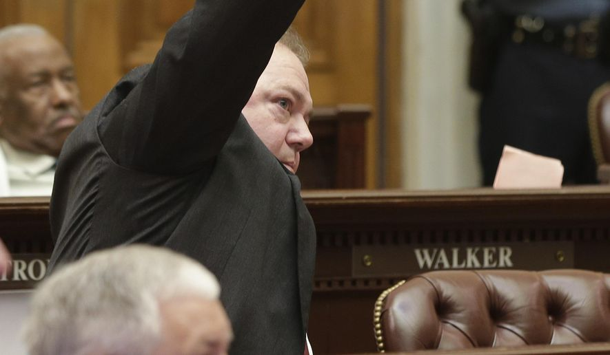 Rep. David Whitaker, D-Fayetteville, center, signals his intention to speak against a bill that chafes Arkansas primary election dates in the House chamber at the Arkansas state Capitol in Little Rock, Ark., Wednesday, May 27, 2015. The bill passed. (AP Photo/Danny Johnston)