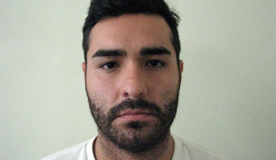 """In this photo provided by Mexico's attorney general's office, shows fugitive former Los Angeles police officer Henry Solis, 27, after he was captured by Mexican security forces in the border city of Ciudad Juarez, Mexico, Tuesday, May 26, 2015. Solis was charged with killing a man during an off-duty fight outside a nightclub in Pomona, California on March 13. """"Henry Solis will be put at the disposition of Mexico's migration office so that he can be handed over to the appropriate authorities,"""" a statement from the office said. (Mexico's Attorney Generals Office via AP)"""