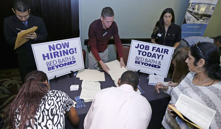 FILE - In this Oct. 22, 2014 file photo, job seekers fill out a job applications at a job fair in Miami Lakes, Fla. The Labor Department reports on state unemployment rates for April on Wednesday, May 27, 2015. (AP Photo/Alan Diaz, File)