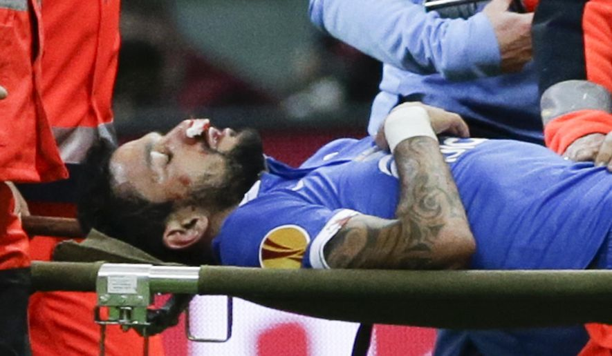 Dnipro's Matheus is carried off the pitch during the final of the soccer Europa League between FC Dnipro Dnipropetrovsk and Sevilla FC at the National Stadium in Warsaw, Poland, Wednesday, May 27, 2015. (AP Photo/Czarek Sokolowski)
