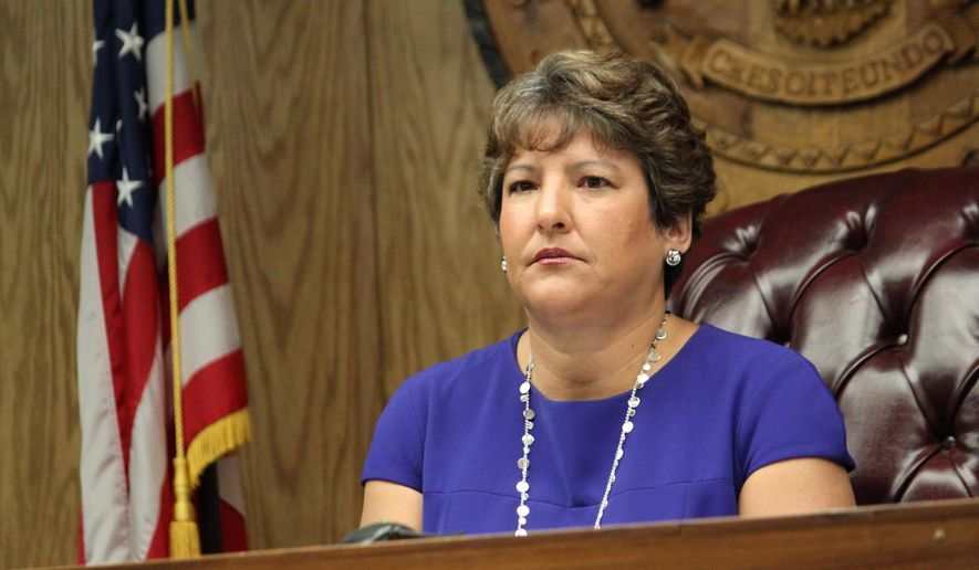 New Mexico Public Regulation Commission Chairwoman Karen Montoya listens to debate on whether to give Public Service Co. of New Mexico more time to reach agreements with a coal company during the commission's meeting in Santa Fe, N.M., on Wednesday, May 27, 2015. The commission voted 4-1 to give the utility until Aug. 31 to reach final agreements with the company, delaying a decision that will affect the future of the San Juan Generating Station. (AP Photo/Susan Montoya Bryan)