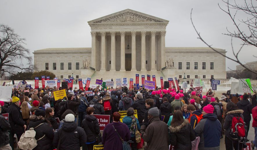Americans are waiting for a Supreme Court decision in King v. Burwell, a major test of President Obama's health care overhaul that could halt insurance premium subsidies in all the states where the federal government runs the marketplaces. (Associated Press)