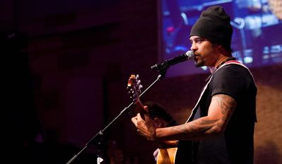 Michael Franti performs at the Fillmore in Silver Spring on Thursday, June 4. Franti has been playing music across the globe for three decades. (Associated Press)