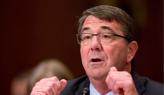 Defense Secretary Ashton Carter Wednesday challenged Chinese pressure for U.S. warships and surveillance aircraft to halt all operations near disputed islands in the strategic waters that China is claiming as its sovereign maritime domain. (Associated Press)