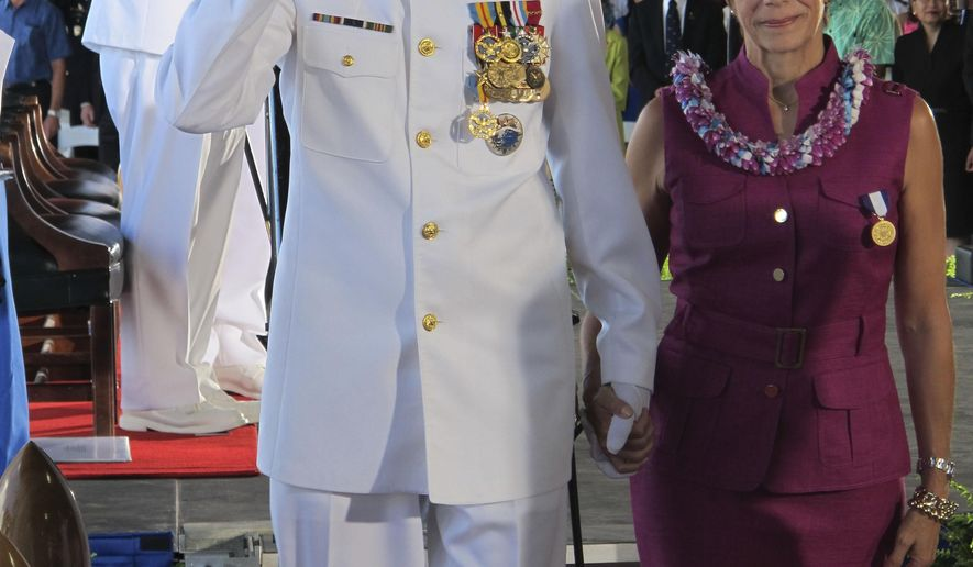 Adm. Samuel Locklear, left, salutes as he and his wife Pamela Locklear leave a change of command ceremony in Pearl Harbor, Hawaii on Wednesday, May 27, 2015. Adm. Harry Harris replaced Locklear as the head of the U.S. Pacific Command. (AP Photo/Audrey McAvoy)