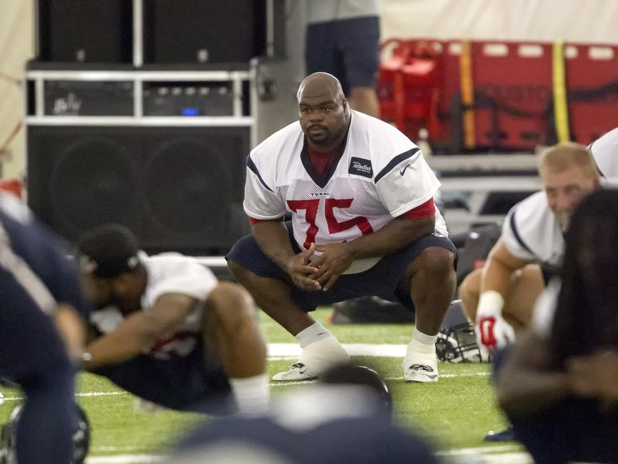 Houston Texans nose tackle Vince Wilfork (75) works out during an NFL football organized team activity, Wednesday, May 27, 2015, in Houston. (AP Photo/Bob Levey)
