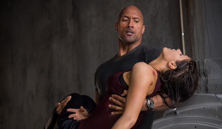 "This photo provided by Warner Bros. Pictures shows Dwayne Johnson, left, as Ray, and Alexandra Daddario as Blake, in a scene from the action thriller, ""San Andreas."" The movie releases in theaters on May 29, 2015.  (Jasin Boland/Warner Bros. Pictures via AP)"