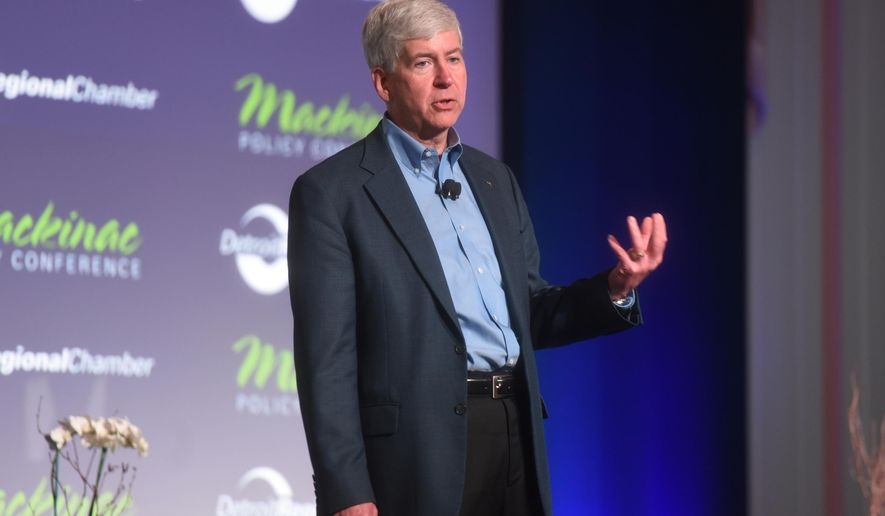 Gov. Rick Snyder speaks at the opening session of the Mackinac Policy Conference Wednesday May 27, 2015,on Mackinac Island, Mich. Prominent Detroit-area business and community leaders say the Republican-led Legislature has no excuse to ignore Detroit Public School's debt because the state ultimately is constitutionally responsible for it.  (Tanya Moutzalias/The Ann Arbor News via AP) LOCAL TELEVISION OUT; LOCAL INTERNET OUT