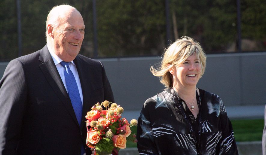 King Harald V of Norway, left, walks with Anchorage Museum CEO Julie Decker on Wednesday, May 27, 2015, after arriving at the museum for a tour in Anchorage, Alaska. The king's visit to the United States included stops in Washington state and Alaska. (AP Photo/Mark Thiessen)