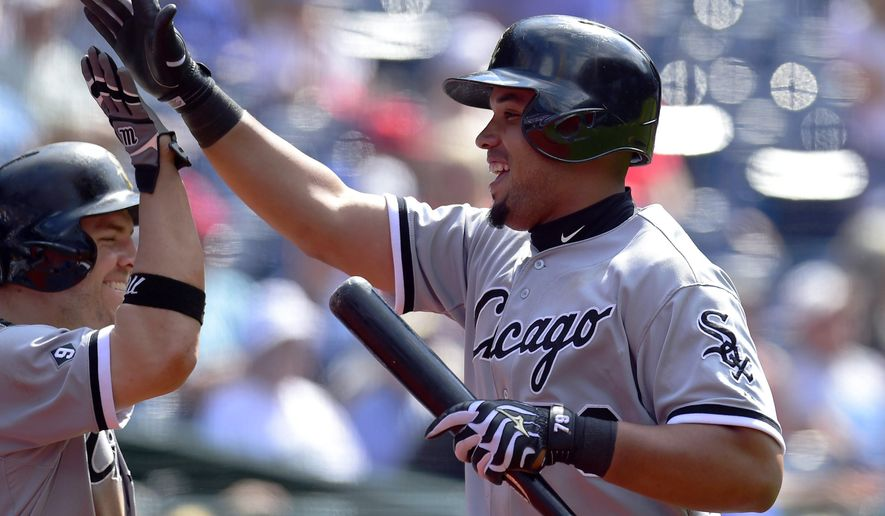 Chicago White Sox Jose Abreu is congratulated after scoring the go-ahead run against the Toronto Blue Jays during tenth inning American League baseball action in Toronto on Wednesday, May 27, 2015. (Frank Gunn(/The Canadian Press via AP) MANDATORY CREDIT