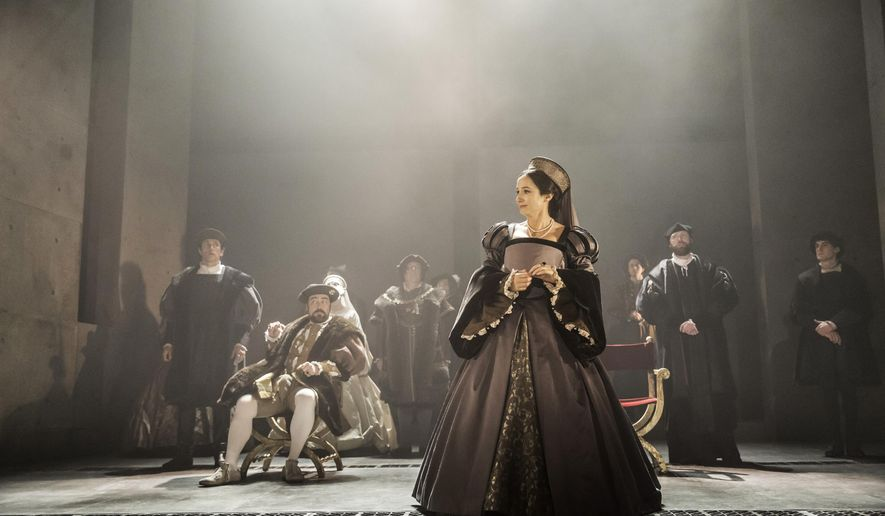"""This photo provided by Jeffrey Richards Associates shows, from left, Ben Miles (standing) as William Cromwell, Nathaniel Parker (seated) as Henry VIII and Lydia Leonard as Anne Boleyn, in a scene from The Shakespeare Company production of Mantel's """"Wolf Hall,"""" directed by Jeremy Herinn. (Johan Persson/Jeffrey Richards Associates via AP)"""