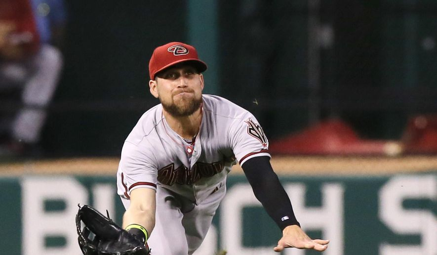 Arizona Diamondbacks left fielder Ender Inciarte catches a fly ball by St. Louis Cardinals' Matt Adams during the third inning of a baseball game Tuesday, May 26, 2015, in St. Louis. The Cardinals won 6-4. (Chris Lee/St. Louis Post-Dispatch via AP)