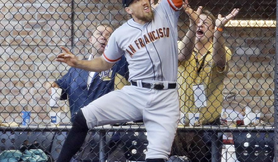San Francisco Giants right fielder Hunter Pence can't catch a ball hit by Milwaukee Brewers' Khris Davis during the fourth inning of a baseball game Wednesday, May 27, 2015, in Milwaukee. (AP Photo/Morry Gash)