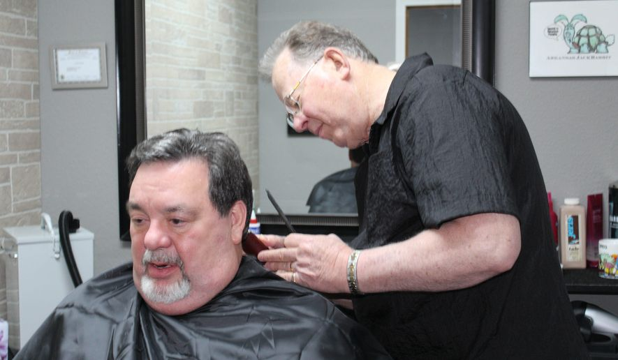 "In this April 23, 2015 photo, Barber Greg Rogers trims the hair of friend Rich Heinkel at Bella 360 Salon in Lena, Ill. Rogers moved to Lena from Freeport in 1964 to open his barbershop, which was practically a Lena landmark when heart problems forced an early retirement years ago. He and his wife, Rosie, moved to Florida 11 years ago for his health, then to Arkansas. They returned to the area in the fall to be closer to family and Rogers returned to barbering at the salon owned by the woman who bought his barbershop. ""I'm feeling great now,"" he said. ""I just got tired of sitting around doing nothing."" (Cindy Scott Day/The Journal-Standard via AP)"