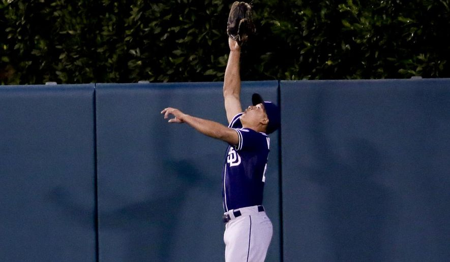 San Diego Padres center fielder Will Venable catches a fly ball hit by Los Angeles Angels' Mike Trout during the third inning of a baseball game in Anaheim, Calif., Tuesday, May 26, 2015. (AP Photo/Chris Carlson)