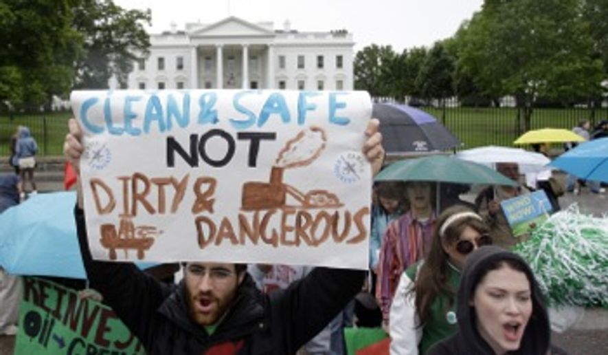 "Demonstrators stand in front of the White House to protest drilling of fossil fuels on May 11, 2010. Along with handheld signs, they displayed a 50-foot banner signed by Gulf residents and marched from the Department of Interior to the White House. The banner read ""Obama: this is your crude awakening."" (Associated Press) **FILE**"