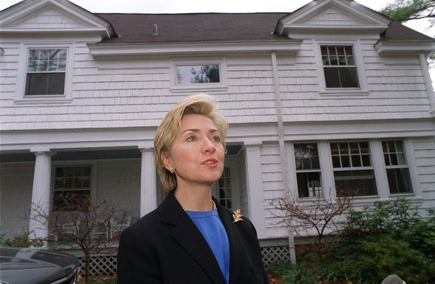 In this Nov. 3, 1999, file photo, then-first lady Hillary Rodham Clinton speaks to the media in front of the Clinton's newly purchased home in Chappaqua, N.Y., The server computer that transmitted and received Hillary Clinton's emails on a private account she used exclusively for official business when she was secretary of state traced back to a residential Internet service registered at her family's five-bedroom home in Chappaqua, according to Internet records reviewed by The Associated Press. (AP Photo/Stephen Chernin, File)