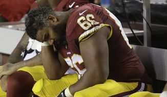 Washington Redskins guard Chris Chester (66) sits on the bench during the second half of an NFL Thursday night football game against the New York Giants in Landover, Md., Thursday, Sept. 25, 2014. The Giants defeated the Redskins 45-14. (AP Photo/Patrick Semansky)