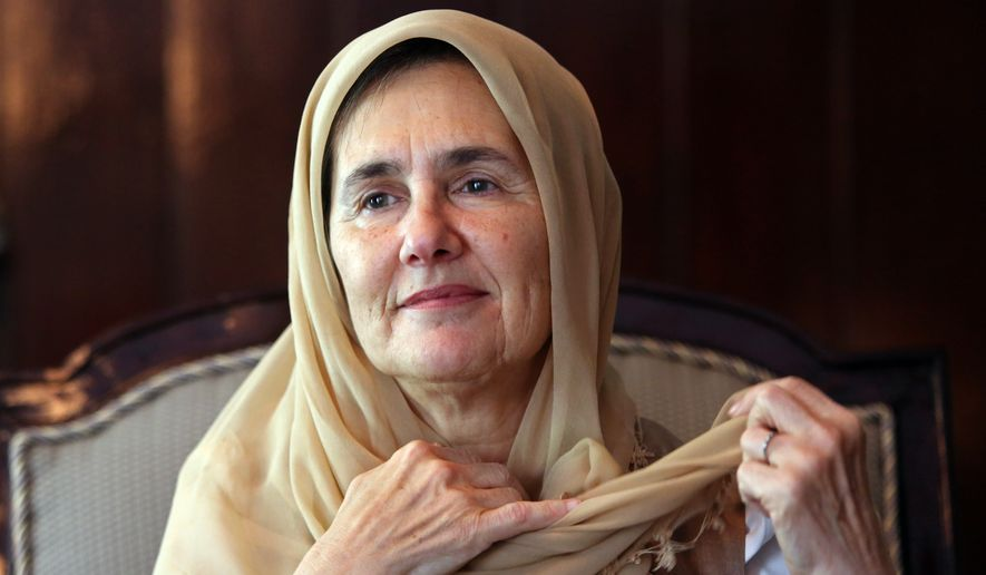 Afghan first lady Rula Ghani adjusts her head scarf during an interview with The Associated Press at the presidential palace in Kabul, Afghanistan, in this Monday, May 25, 2015, file photo. Rula Ghani has been quietly breaking conventions since she became first lady in a society that traditionally keeps its women behind closed doors. (AP Photo/Rahmat Gul)