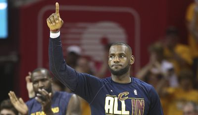 Cleveland Cavaliers forward LeBron James reacts on the sidelines late in the second half of Game 4 of the NBA basketball Eastern Conference Finals against the Atlanta Hawks, Tuesday, May 26, 2015, in Cleveland. (AP Photo/Ron Schwane)