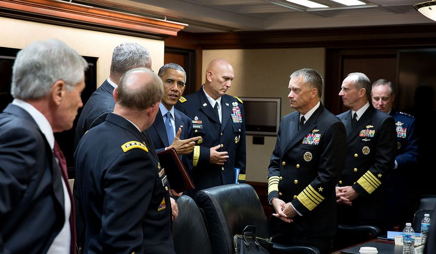 President Barack Obama talks with the Joint Chiefs of Staff following a meeting in the Situation Room of the White House, Oct. 28, 2014. (Official White House Photo by Pete Souza)