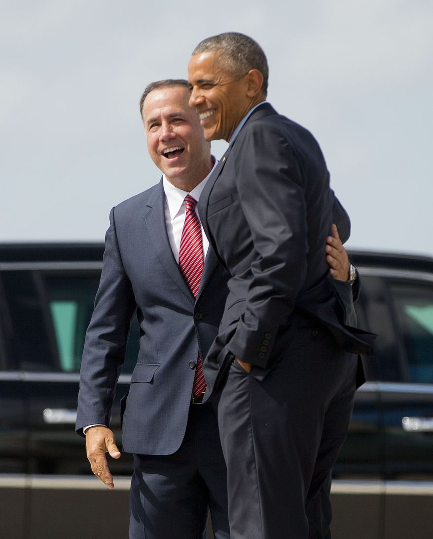 President Barack Obama is greeted by Miami Beach, Fla. Mayor Philip Levine upon his arrival on Air Force One at Miami International Airport, Wednesday, May 27, 2015, in Miami, Fla. Obama traveled to Miami to raise money for the Democratic National Committee at a pair of events at the homes of well-heeled political donors and tomorrow he will visit the National Hurricane Center to draw attention to preparedness in advance of the annual storm season that formally begins June 1. (AP Photo/Pablo Martinez Monsivais)