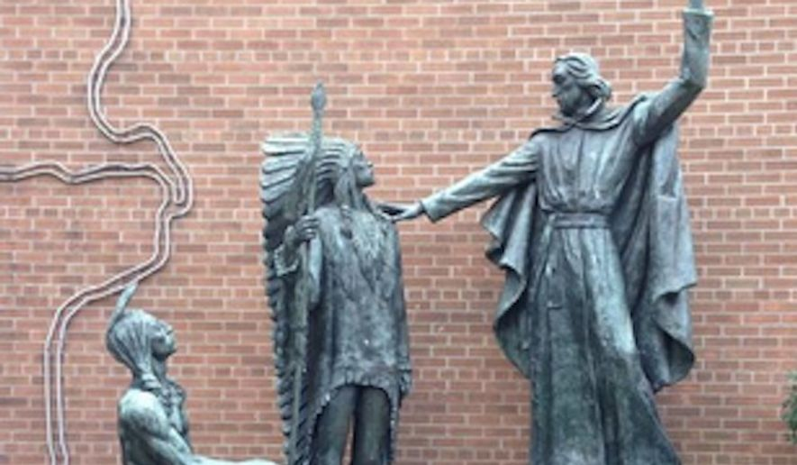 Saint Louis University has removed a statue depicting Fr. Pierre-Jean De Smet, a prominent Jesuit missionary and Roman Catholic priest, praying over two Native Americans following pressure from faculty and staff who complained it represented white supremacy. (Twitter/@EmmaculateJones)