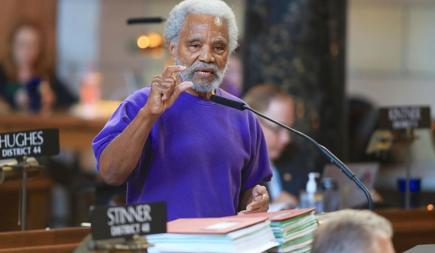 Nebraska state Sen. Ernie Chambers of Omaha speaks in Lincoln, Neb., Wednesday, May 27, 2015, during debate on overriding Gov. Pete Ricketts' veto of a death penalty repeal bill, in a vote that would make it the first traditionally conservative state to abolish capital punishment in more than four decades. (AP Photo/Nati Harnik)