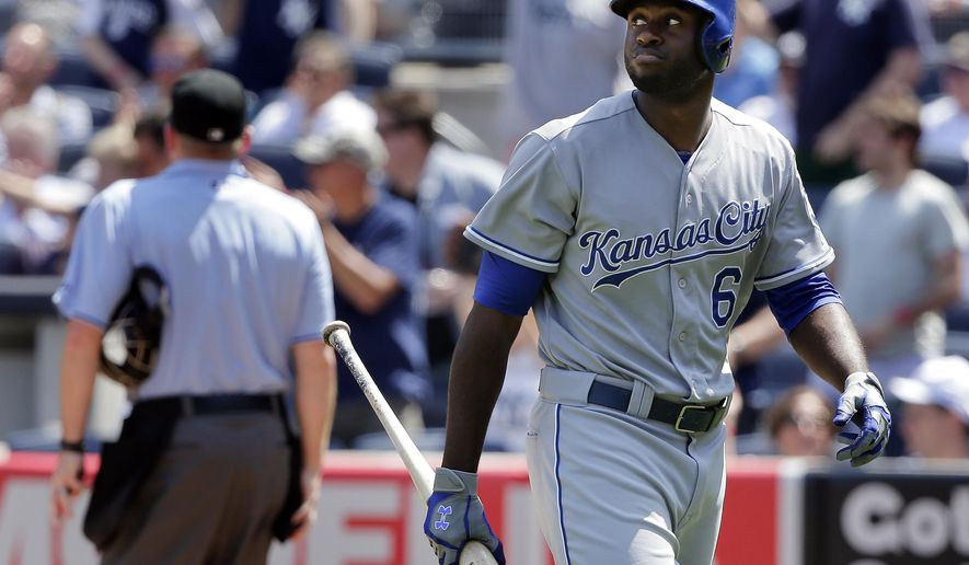 Kansas City Royals Lorenzo Cain looks back at the scoreboard after striking out with two men on base to end the top of the fifth inning of a baseball game against the New York Yankees, Wednesday, May 27, 2015, in New York. (AP Photo/Julie Jacobson)