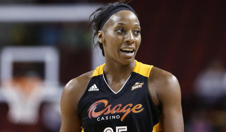 FILE - In this May 17, 2013, file photo, Tulsa Shock's Glory Johnson pauses during the team's preseason WNBA basketball game against the Seattle Storm in Seattle. Johnson had no idea her fight with Brittney Griner would become such a big deal. (AP Photo/Elaine Thompson, File)