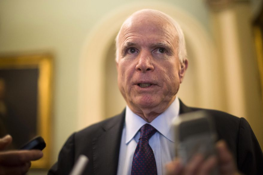 Senate Armed Services Committee Chairman Sen. John McCain, R-Ariz. speaks to reporters on Capitol Hill in Washington in this May 5, 2015, file photo. (AP Photo/Brett Carlsen, File)