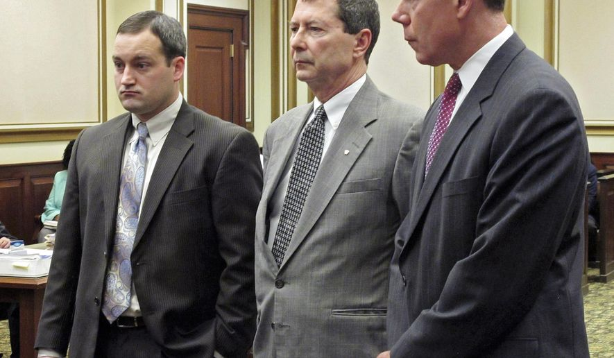 FILE - In this April 7, 2014 file photo, Ohio state representative Pete Beck, center, stands in Hamilton County Common Pleas Court in Cincinnati with his lawyers Chad Ziepfel, left, and Ralph Kohnen during a hearing. Closing arguments began Wednesday, May 27, 2015 in the trial of a former lawmaker accused of defrauding a technology company's investors out of millions of dollars. (AP Photo/Amanda Myers, File)