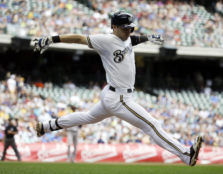 Milwaukee Brewers' Ryan Braun stretches out as he runs to first base during the sixth inning of a baseball game against the San Francisco Giants Wednesday, May 27, 2015, in Milwaukee. Braun was out at first on the ground ball. (AP Photo/Morry Gash)