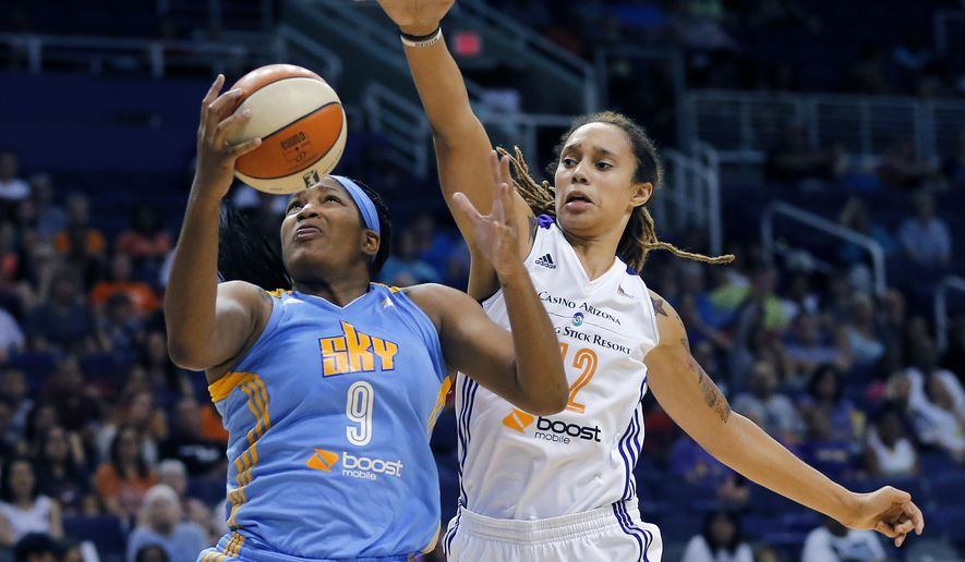 FILE - In this July 2, 2014, file photo, Chicago Sky center Markeisha Gatling (9) shoots past Phoenix Mercury center Brittney Griner (42) during a WNBA basketball game in Phoenix. Glory Johnson had no idea her fight with Griner would become such a big deal. After the engaged WNBA All-Stars stars battled so intensely at their home that the police were called, the couple immediately began working through the incident together. (AP Photo/Matt York, File)