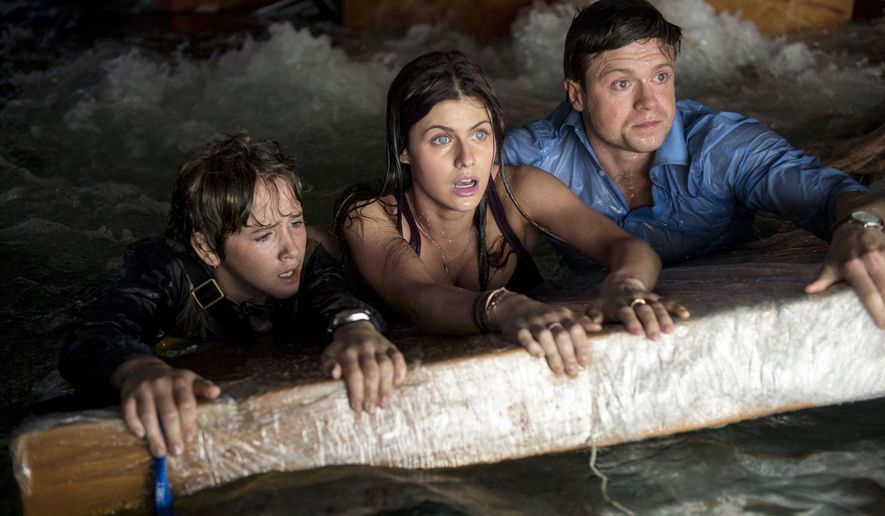 "This photo provided by Warner Bros. Pictures shows, from left, Art Parkinson as Ollie, Alexandra Daddario as Blake, and Hugo Johnstone-Burt as Ben, in a scene from the action thriller ""San Andreas.""  (AP)"