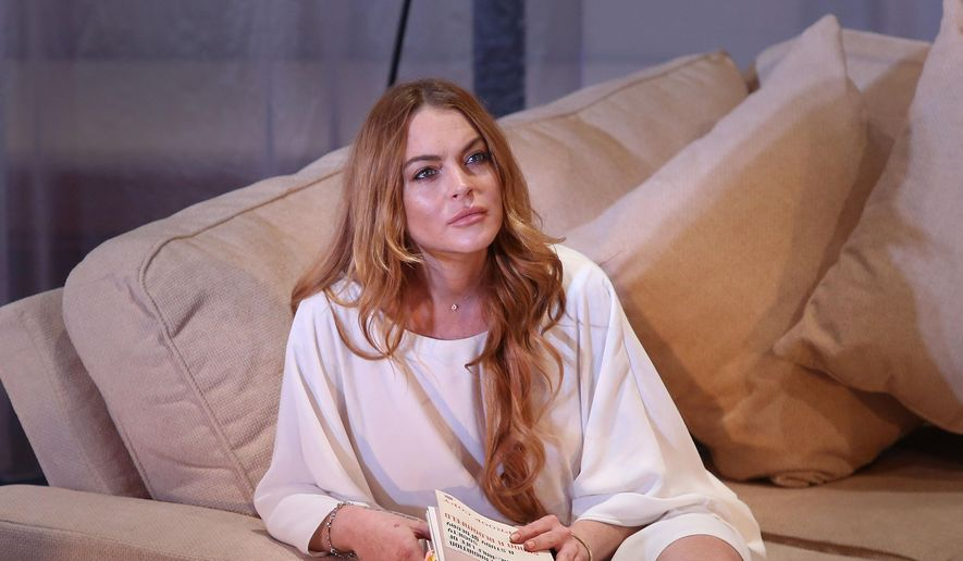 "In this Tuesday, Sept. 30, 2014, file photo, U.S actress Lindsay Lohan performs a scene from the play, ""Speed the Plow,"" during a photocall at the Playhouse Theatre in central London. (Photo by Joel Ryan/Invision/AP, File)"