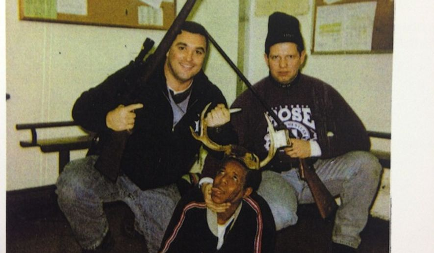 A photograph taken more than a decade ago that shows two smiling Chicago police officers posing over a black drug suspect has been rebuked by police superintendent Garry McCarthy after the Chicago Sun-Times published it on Tuesday. (Cook County court file via Chicago Sun-Times)