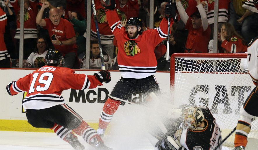 Chicago Blackhawks left wing Brandon Saad celebrates his goal against Anaheim Ducks goalie Frederik Andersen with Jonathan Toews (19) during the second period in Game 6 of the Western Conference finals of the NHL hockey Stanley Cup Playoffs, Wednesday, May 27, 2015, in Chicago. (AP Photo/Nam Y. Huh)