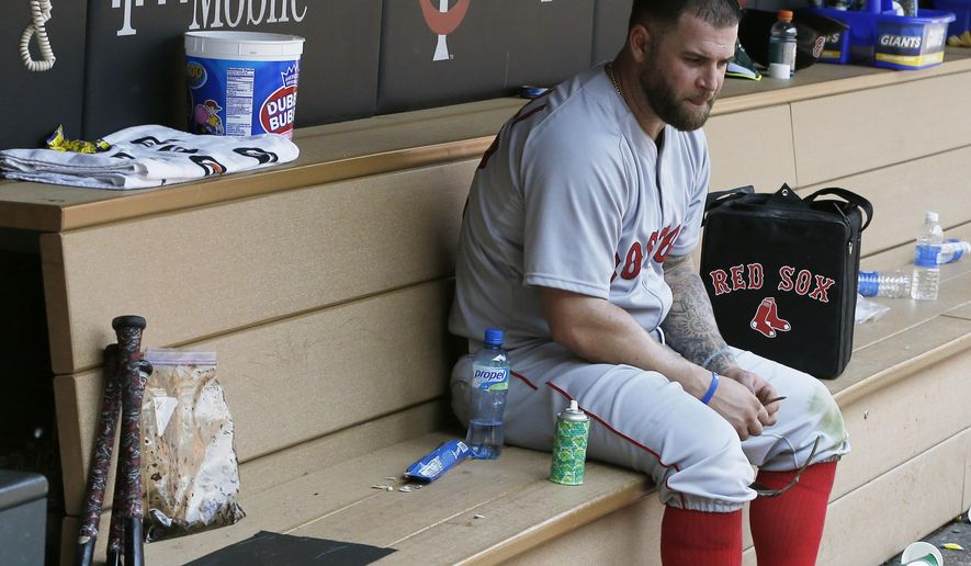Boston Red Sox' Mike Napoli sits alone in the dugout after the Minnesota Twins beat the Red Sox 6-4  in a baseball game, Wednesday May 27, 2015, in Minneapolis. TheTwins swept the three-game series. (AP Photo/Jim Mone)